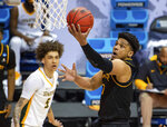 Appalachian State guard Justin Forrest (1) drives to the basket to score with a layup during the first half of a First Four game against Norfolk State in the NCAA men's college basketball tournament, Thursday, March 18, 2021, in Bloomington, Ind. (AP Photo/Doug McSchooler)