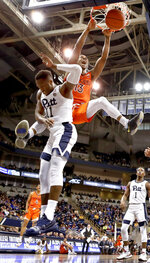 Virginia Tech's Ahmed Hill, right, dunks behind Pittsburgh's Sidy N'Dir (11) during the first half of an NCAA college basketball game, Saturday, Feb. 16, 2019, in Pittsburgh. (AP Photo/Keith Srakocic)