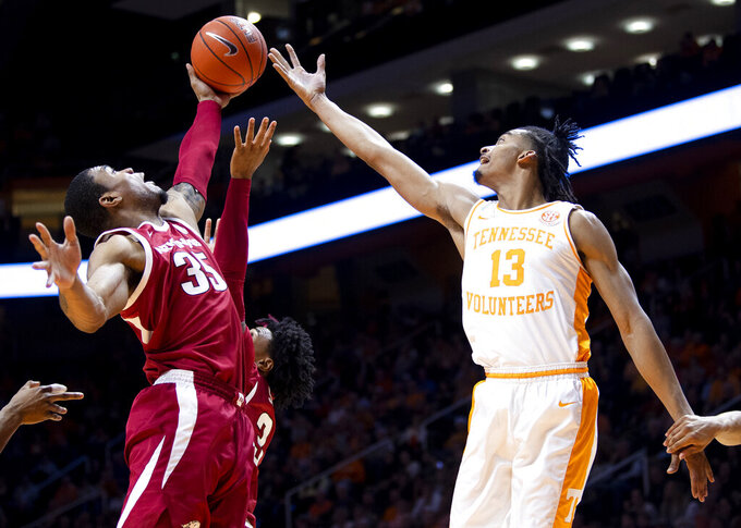 Arkansas forward Reggie Chaney (35) and Tennessee guard Jalen Johnson (13) reach for the rebound during an NCAA college basketball game, Tuesday, Feb. 11, 2020 in Knoxville, Tenn. (Brianna Paciorka/Knoxville News Sentinel via AP)