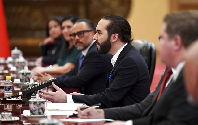 El Salvador's President Nayib Bukele, talks to Chinese President Xi Jinping at the Great Hall of the People in Beijing, China, Tuesday, Dec.3, 2019. ( Noel Celis, Pool Photo via AP)
