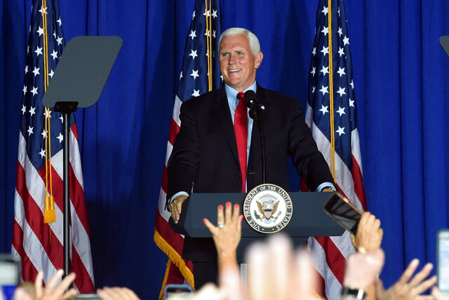Vice President Mike Pence speaks during a campaign rally at an airplane hangar, Tuesday, Oct. 27, 2020, in Greenville, S.C. (AP Photo/Meg Kinnard)