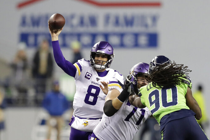 Minnesota Vikings quarterback Kirk Cousins (8) throws against the Seattle Seahawks during the first half of an NFL football game, Monday, Dec. 2, 2019, in Seattle. (AP Photo/John Froschauer)