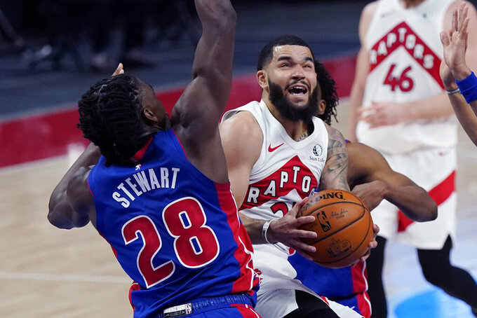 Toronto Raptors guard Fred VanVleet looks to shoot as Detroit Pistons center Isaiah Stewart (28) defends during the first half of an NBA basketball game, Wednesday, March 17, 2021, in Detroit. (AP Photo/Carlos Osorio)