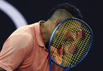 Australia's Nick Kyrgios reacts after losing a point to Russia's Karen Khachanov during their third round singles match at the Australian Open tennis championship in Melbourne, Australia, Saturday, Jan. 25, 2020. (AP Photo/Lee Jin-man)