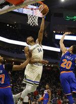 Milwaukee Bucks' Giannis Antetounmpo (34) shoots against the New York Knicks during the second half of an NBA basketball game Monday, Dec. 2, 2019, in Milwaukee. (AP Photo/Jeffrey Phelps)