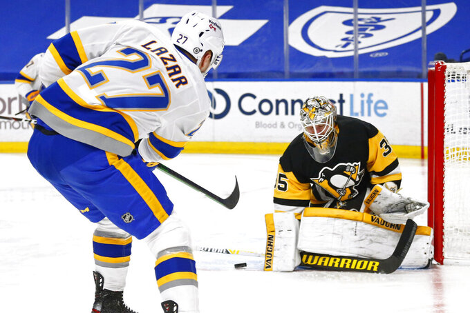 Buffalo Sabres forward Curtis Lazar (27) is stopped by Pittsburgh Penguins goalie Tristan Jarry (35) during the second period of an NHL hockey game, Thursday, March 11, 2021, in Buffalo, N.Y. (AP Photo/Jeffrey T. Barnes)