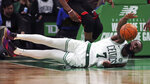 Boston Celtics guard Jaylen Brown (7) dives the ball during the second half of an NBA basketball game against the Miami Heat in Boston, Wednesday, Dec. 4, 2019. (AP Photo/Charles Krupa)
