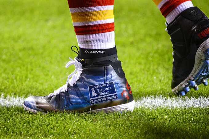 "Kansas City Chiefs defensive tackle Derrick Nnadi (91) wears his ""My Cause My Cleats"" shoes during pre-game warmups before an NFL football game against the Denver Broncos, Sunday, Dec. 6, 2020, in Kansas City, Mo. Five years ago, about 500 players participated in the inaugural campaign, marking the first time players could wear custom cleats during games without facing fines. This year, more than 1,000 players took part, wearing their cleats during Week 13 games to raise awareness and funds for various causes. (AP Photo/Reed Hoffmann)"