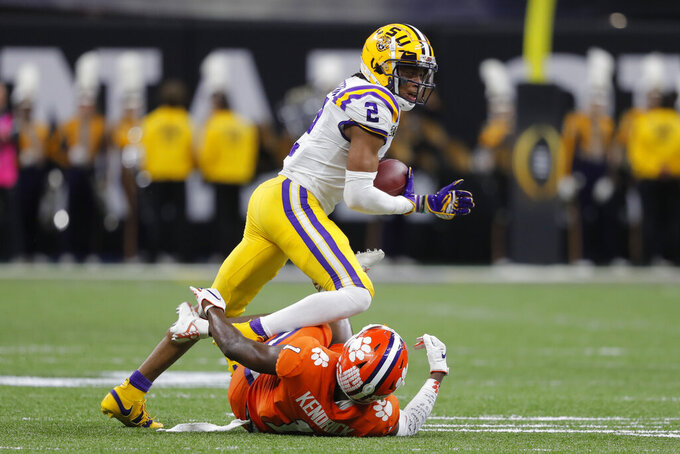 LSU wide receiver Justin Jefferson runs over Clemson cornerback Derion Kendrick during the first half of a NCAA College Football Playoff national championship game Monday, Jan. 13, 2020, in New Orleans. (AP Photo/Gerald Herbert)