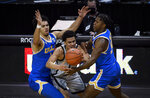 UCLA guard Jules Bernard (1) and UCLA guard David Singleton (34) pressure Oregon guard Will Richardson (0) during the second half of an NCAA college basketball game Wednesday, March 3, 2021, in Eugene, Ore. (AP Photo/Andy Nelson)