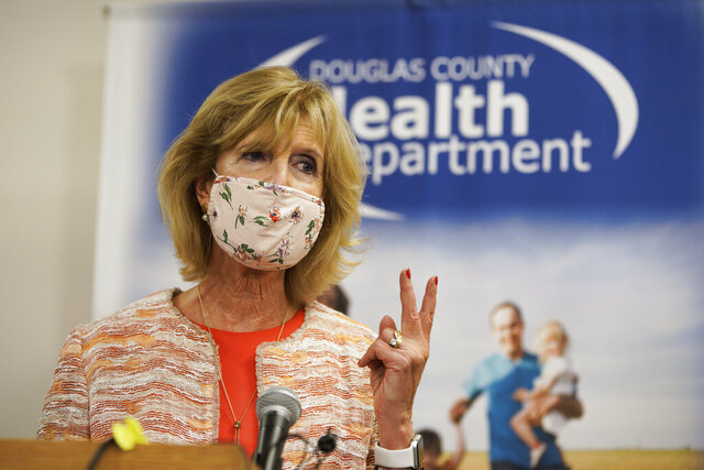 Douglas County Health Director Dr. Adi Pour speaks during a news conference at the Douglas County Health Department in Omaha, Neb., Friday, July 31, 2020. Dr. Pour said she won't issue an order requiring people in the county and Omaha to wear masks to help slow the spread of the coronavirus, despite a unanimous vote by the county's health board to do so. The rejection of the health board's mandate came after Gov. Pete Ricketts and the state attorney general's office contacted local authorities to insist that such a requirement would violate state law. (AP Photo/Nati Harnik)
