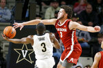 Vanderbilt guard Maxwell Evans, left, drives against Alabama forward Alex Reese in the second half of an NCAA college basketball game Wednesday, Jan. 22, 2020, in Nashville, Tenn. Alabama won 77-62. (AP Photo/Mark Humphrey)