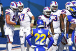 Buffalo Bills quarterback Josh Allen (17) celebrates with teammates after scoring a touchdown as Los Angeles Rams cornerback Troy Hill (22) watches during the first half of an NFL football game Sunday, Sept. 27, 2020, in Orchard Park, N.Y. (AP Photo/Adrian Kraus)