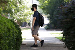 A student, wearing a mask, walks on campus at the University of Georgia, Thursday, Aug. 20, 2020. in Athens, Ga. (Joshua L. Jones/Athens Banner-Herald via AP)