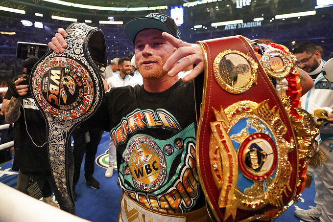 Canelo Alvarez celebrates after defeating Billy Joe Saunders in a unified super middleweight world championship boxing match, Saturday, May 8, 2021, in Arlington, Texas.(AP Photo/Jeffrey McWhorter)