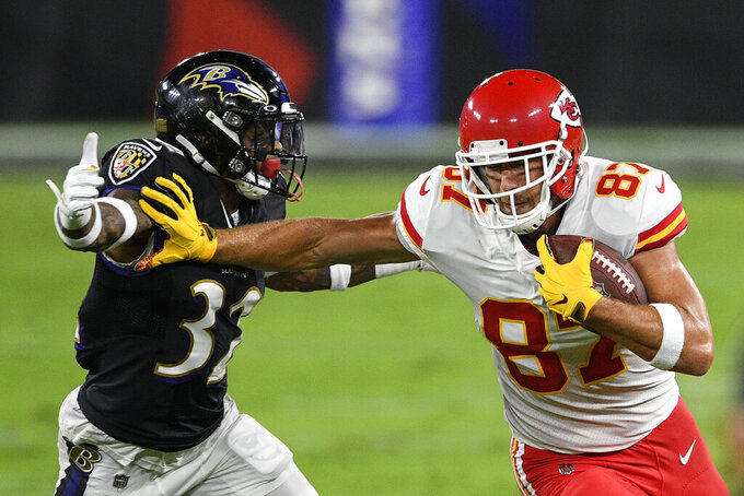 Kansas City Chiefs tight end Travis Kelce (87) stiff-arms Baltimore Ravens free safety DeShon Elliott (32) during the first half of an NFL football game Monday, Sept. 28, 2020, in Baltimore. (AP Photo/Nick Wass)
