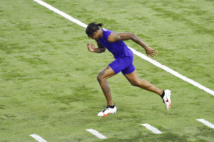 Clemson football player Tee Higgins runs the 40-yard dash during NFL Pro Day Thursday, March 12, 2020, in Clemson, S.C. (AP Photo/Richard Shiro)