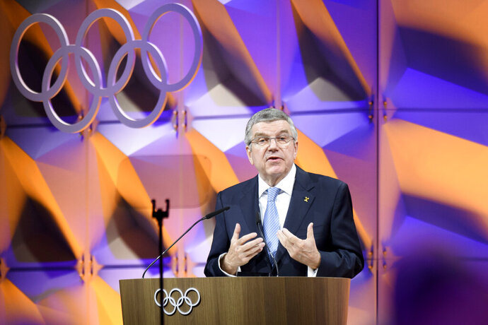Thomas Bach, president of the International Olympic Committee (IOC), delivers a speech during the 135th Session of the IOC on the sideline of the the 3rd Winter Youth Olympic Games Lausanne 2020, at the SwissTech Convention Centre, in Lausanne, Switzerland, Friday, Jan. 10, 2020. (Laurent Gillieron/Keystone via AP)