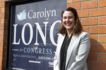 In this Aug. 22, 2108 photo, Carolyn Long, a Democratic candidate in the 3rd Congressional District race, stands in front of her campaign office as she poses for a photo in Vancouver, Wash. Long is challenging Republican incumbent U.S. Rep. Jaime Herrera Beutler. (AP Photo/Rachel La Corte)