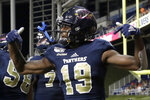 FIU wide receiver Shemar Thornton (19) celebrates after scoring a touchdown during the first half of an NCAA college football game against Miami, Saturday, Nov. 23, 2019, in Miami. (AP Photo/Lynne Sladky)