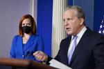 White House press secretary Jen Psaki, left, listens as Gene Sperling, who leads the oversight for distributing funds from President Joe Biden's $1.9 trillion coronavirus rescue package, speaks during the daily briefing at the White House in Washington, Monday, Aug. 2, 2021. (AP Photo/Susan Walsh)