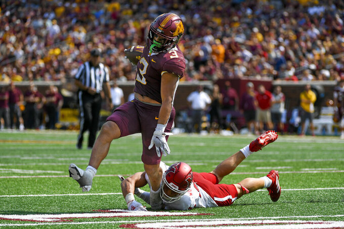Minnesota running back Trey Potts (3) slips past Miami-Ohio defensive back Sterling Weatherford to run 21-yards for a touchdown during the second half of an NCAA college football game on Saturday, Sept. 11, 2021, in Minneapolis. (AP Photo/Craig Lassig)