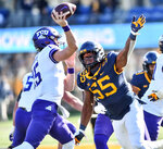 West Virginia  defensive lineman Dante Stills (55) rushes TCU quarterback Max Duggan (15) during the first half of an NCAA college football game on Saturday, Nov. 14, 2020, in Morgantown, W.Va. (William Wotring/The Dominion-Post via AP)