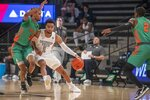 Georgia Tech guard Kyle Sturdivant (1) dribbles downcourt against Florida A&M during the first half of an NCAA college basketball game in Atlanta, Friday, Dec. 18, 2020. (Alyssa Pointer/Atlanta Journal-Constitution via AP)