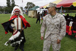 In this June 15, 2012, file photo, Blas Preciado, left, a Vietnam War veteran of the Kiowa tribe, talks with Marine Cpl. Frank Tartsah, right, also of the Kiowa tribe, during a Native American blessing for veteran and active-duty servicemen in Camp Pendleton, Calif.