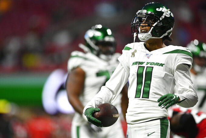 New York Jets wide receiver Robby Anderson (11) reacts to a catch against the Atlanta Falcons during the first half an NFL preseason football game, Thursday, Aug. 15, 2019, in Atlanta. (AP Photo/John Amis)