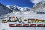 In this April 30, 2020, aerial photo released by China's Xinhua News Agency, vehicles and tents are seen at the base camp at the foot of the peak of Mount Qomolangma, also known as Mount Everest, in southwestern China's Tibet Autonomous Region. China sent scientists to climb Mount Everest while the world's highest peak is empty of commercial climbers because of the coronavirus pandemic. (Purbu Zhaxi/Xinhua via AP)