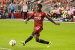 Toronto FC defender Rocco Romeo kicks the ball during the first half of the team's MLS soccer match against Inter Miami on Tuesday, Sept. 14, 2021, in Toronto. (Christopher Katsarov/The Canadian Press via AP)