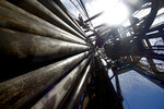 FILE - In this July 28, 2010 file photo, drilling pipes are seen rising to the top of the Murphy Front Runner deep water oil drilling rig in the Gulf of Mexico, off the coast of Louisiana. Attempts to curb the spread of COVID-19 have visited a kind of triple economic whammy on the state. As oil prices have plummeted, the industry laid off workers. Tourism has dried up, meaning more lost jobs. And one major tourist draw — cuisine built around fin fish, shrimp, oyster and crabs — is also suffering. (AP Photo/Gerald Herbert, File)