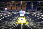 FILE - In this Aug. 26, 2019, file photo, the Golden State Warriors championship banners hang above the seating and basketball court at the Chase Center in San Francisco. The Warriors will play the Brooklyn Nets at home Thursday night, March 12, 2020, in the first NBA game without fans since the outbreak of the coronavirus. (AP Photo/Eric Risberg, File)