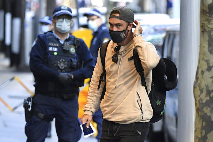 Australian cricketer Glenn Maxwell arrives for hotel quarantine at the Marriott Hotel in Sydney, Australia, Monday, May 17, 2021. Most of the Australians involved in the suspended Indian Premier League have arrived in Sydney on a charter flight and will go immediately into quarantine. (Joel Carrett/AAP Image via AP)