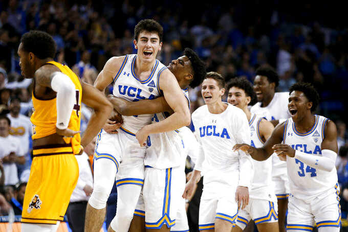 UCLA guard Jaime Jaquez Jr., second from left, celebrates with teammates after the team's win over Arizona State in an NCAA college basketball game Thursday, Feb. 27, 2020, in Los Angeles. (AP Photo/Ringo H.W. Chiu)
