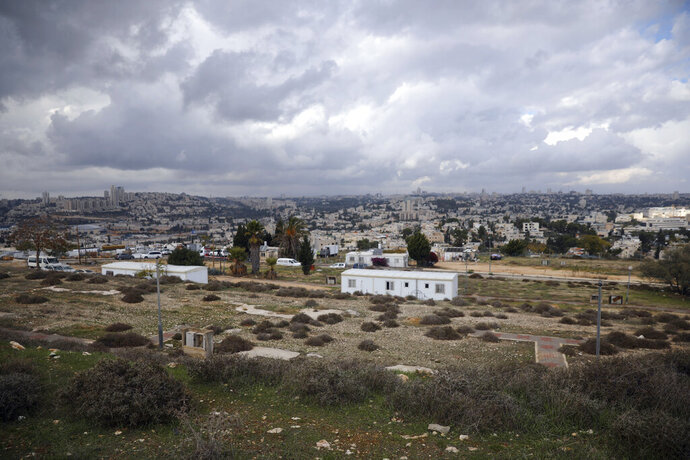 FILE - This Nov. 15, 2020 file photo, shows a general view of the Givat Hamatos Israeli settlement in east Jerusalem. Israeli authorities on Sunday, Jan. 17, 2021, advanced plans to build an additional 780 homes in West Bank settlements, an anti-settlement monitoring group said, in a last-minute surge of approvals before the friendly Trump administration leaves office later this week. Peace Now said that over 90% of the homes lay deep inside the West Bank, which the Palestinians seek as the heartland of a future independent state. (AP Photo/Mahmoud Illean, File)