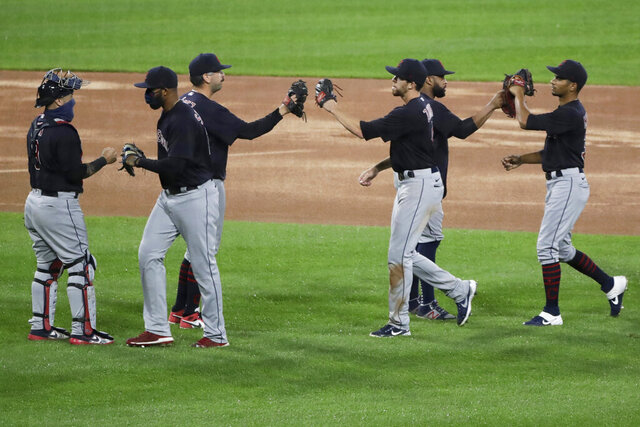 Cleveland Indians players celebrate after the Indians defeated the Chicago White Sox 5-4 in 10 innings in a baseball game in Chicago, Sunday, Aug. 9, 2020. (AP Photo/Nam Y. Huh)
