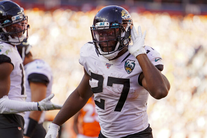 Jacksonville Jaguars running back Leonard Fournette reacts towards the crowd after a gain during the second half of an NFL football game against the Denver Broncos, Sunday, Sept. 29, 2019, in Denver. (AP Photo/Jack Dempsey)