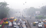 In this Sunday, Nov. 3, 2019, photo, vehicles wait at a crossing amidst morning smog in New Delhi, India. Authorities in New Delhi are restricting the use of private vehicles on the roads under an