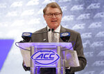 FILE - In this July 18, 2018, file photo, Atlantic Coast Conference commissioner John Swofford speaks during a news conference at the ACC NCAA college football media day in Charlotte, N.C. After the Power Five conference commissioners met Sunday, Aug. 9, 2020, to discuss mounting concern about whether a college football season can be played in a pandemic, players took to social media to urge leaders to let them play.(AP Photo/Chuck Burton, File)