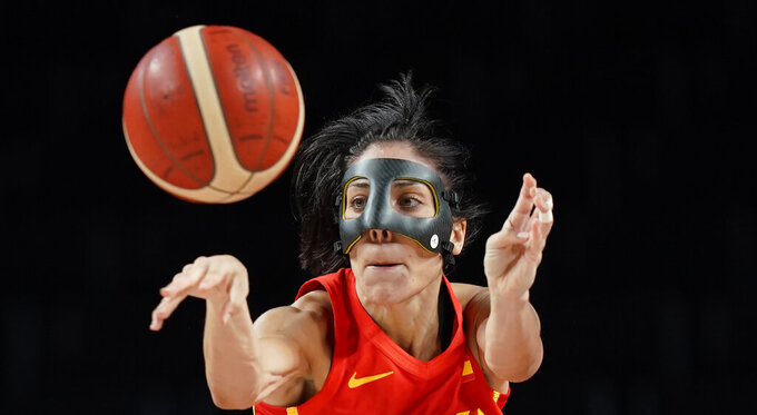 Spain's Cristina Ouvina (5) passes the ball during women's basketball preliminary round game against Canada at the 2020 Summer Olympics, Sunday, Aug. 1, 2021, in Saitama, Japan. (AP Photo/Eric Gay)
