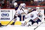 Arizona Coyotes right wing Josh Archibald sends the puck past Edmonton Oilers defenseman Oscar Klefbom (77) and Oilers goaltender Cam Talbot (33) for a goal during the first period of an NHL hockey game, Friday, Jan. 12, 2018, in Glendale, Ariz. (AP Photo/Ross D. Franklin)
