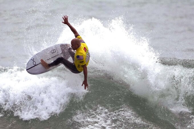 FILE - Surfer Kelly Slater performs during an Olympic exhibition of the USA Surfing Junior championships at the Lower Trestles in San Clemente, Calif., in this Tuesday, June 22, 2021, file photo. There's a lot riding on surfing's Olympic debut: a taste of the mainstream spotlight, the athletic legitimacy for the uniquely four-dimensional sport, and, perhaps, some newfound respect so it can finally shake its stereotype as merely the pleasure pursuit of beach town himbos. (Keith Birmingham/The Orange County Register via AP, File)
