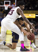 California's Matt Bradley (20) gets double teamed by Arizona State's Romello White (32) and Luguentz Dort (0) during the first half of an NCAA college basketball game Sunday, Feb. 24, 2019, in Tempe, Ariz. (AP Photo/Darryl Webb)