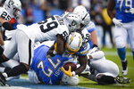 Los Angeles Chargers running back Melvin Gordon scores against the Oakland Raiders during the second half of an NFL football game Sunday, Dec. 22, 2019, in Carson, Calif. (AP Photo/Kelvin Kuo)