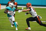 Miami Dolphins wide receiver Jakeem Grant (19) runs the football as Cincinnati Bengals linebacker Logan Wilson (55) attempts to tackle during the second half of an NFL football game, Sunday, Dec. 6, 2020, in Miami Gardens, Fla. (AP Photo/Wilfredo Lee)