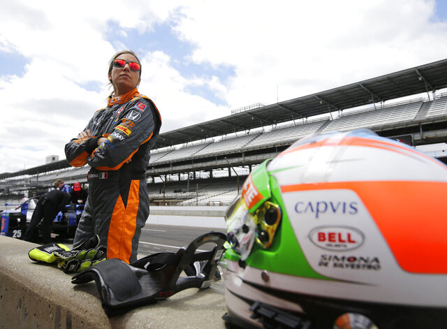 FILE - In this May 12, 2015, file photo, driver Simona de Silvestro, of Switzerland, watches during practice for the Indianapolis 500 auto race at Indianapolis Motor Speedway in Indianapolis. Beth Paretta and Simona de Silvestro will be teaming up to put another woman on the Indianapolis 500 starting grid this May. On Tuesday, Jan. 19, 2021, Paretta Autosport and IndyCar officials announced they would work together to put a predominantly women-run team in the series' biggest race as part of an outreach to create more diversity in motorsports. (AP Photo/Darron Cummings, File)