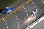 Ryan Newman (6) slides in front of the grandstands on his roof after crossing the finish line during the NASCAR Daytona 500 auto race at Daytona International Speedway, Monday, Feb. 17, 2020, in Daytona Beach, Fla. (AP Photo/Phelan M. Ebenhack)
