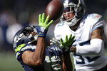 Seattle Seahawks wide receiver Tyler Lockett, left, catches a pass in front of Tennessee Titans strong safety Bradley McDougald for a 51-yard gain during the first half of an NFL football game, Sunday, Sept. 19, 2021, in Seattle. (AP Photo/John Froschauer)